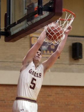 Nick Brennen dunks the ball during Iona Prep's 67-57 victory over Holy Cross on Dec. 15, 2016.