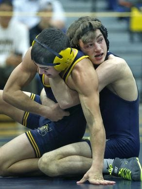 Wayne lightweight Matthew Caccamise, right at the 2015 Teike-Bernabi Tournament, was a state champion last season as a junior.