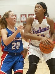 New Albany's Chyna heads to the basket against Rachel Stewart of Pekin Eastern.
