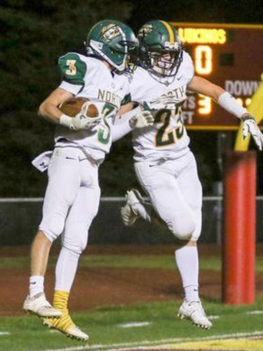 636454930909910899-North-Hunterdon-s-Griffin-Honthy-left-No.-3-celebrates-a-TD-with-teammate-Luke-Ingenito-11-3-17.jpg