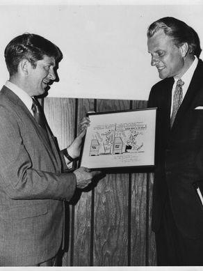 Then-Knoxville Journal cartoonist Charlie Daniel presents Billy Graham with a framed original cartoon during Graham's crusade in Knoxville in 1970.