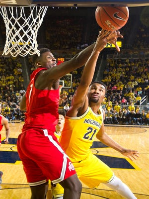 Ohio State defends a shot attempt from Michigan guard Zak Irvin (21) in the first half Saturday at Crisler Center.
