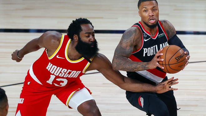 Portland's Damian Lillard drives on Houston's James Harden (13) during Tuesday's win over the Rockets.
