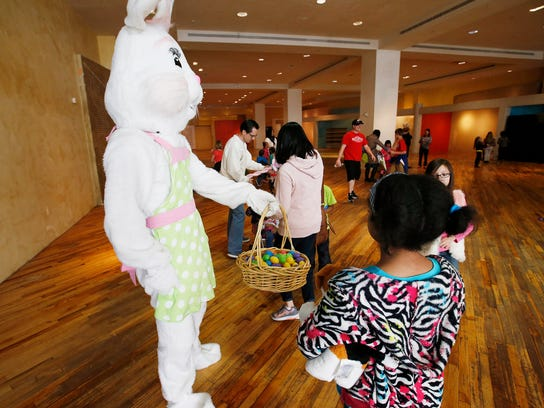 The Easter bunny hands out eggs at Gateway in Salt Lake City Saturday, March 26, 2016.