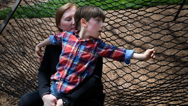 Stefanie Dean Brown spends time with her son Dean 7, who has cerebral palsy at their home Saturday, April 21, 2018, in Nashville, Tenn. Brown calls her son her guardian angel. The birth of Dean helped doctors discover that Stefanie has a rare cancer, LAM, which stands for lymphangioleiomyomatosis.