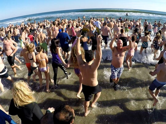 Polar Bear plungers hit the surf just north of Convention