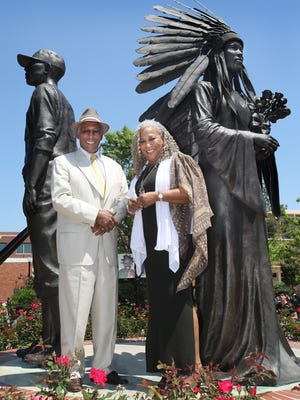 """Fred Flowers and sister Doby Flowers at """"Integration,"""" on the FSU campus. The three-statue tableau honors Fred Flowers as FSU's first black athlete (1965), Doby Flowers as FSU's first black homecoming queen (1970) and Maxwell Courtney, as FSU's first black student (1962). The Flowers are members of the Hadley family, which is holding its 40th annual reunion in Tallahassee this weekend."""