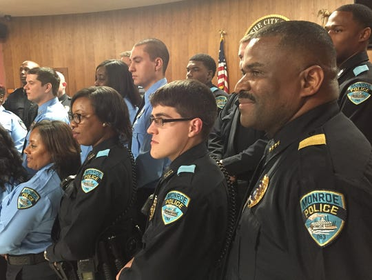 Chief Quentin Holmes stands with the new officers after