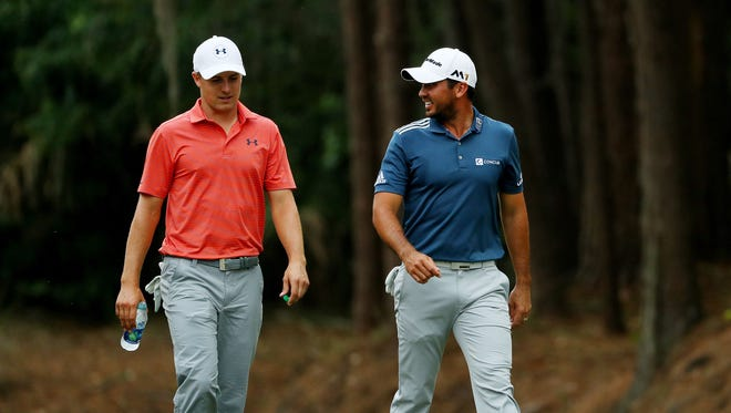 Jordan Spieth of the USA (L) and Jason Day of Australia.