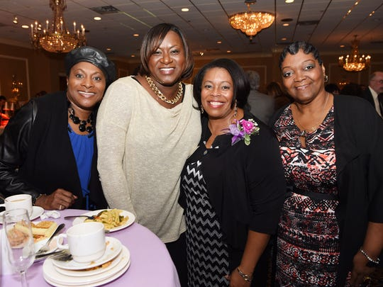 Athena Award nominee the Rev. Luader Smith, center