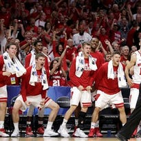 Players on the Wisconsin bench react during the second half of a college basketball regional semifinal against North Carolina in the NCAA Tournament, Thursday, March 26, 2015, in Los Angeles.
