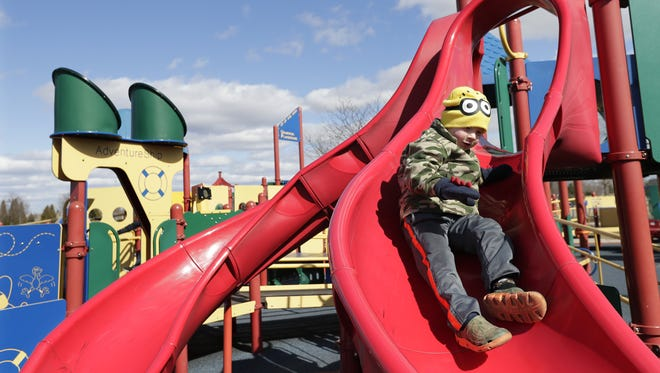 Lincoln Stingle, 4, of Stevens Point plays on a slide recently at Memorial Park in Appleton. City officials are planning to create a community park, similar to Memorial Park, on the city's south side.