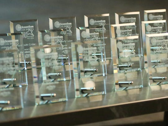 Rows of crystal awards stand on a table waiting to be handed out at the Jackson Sun Under 40 awards ceremony Thursday evening at theCO.