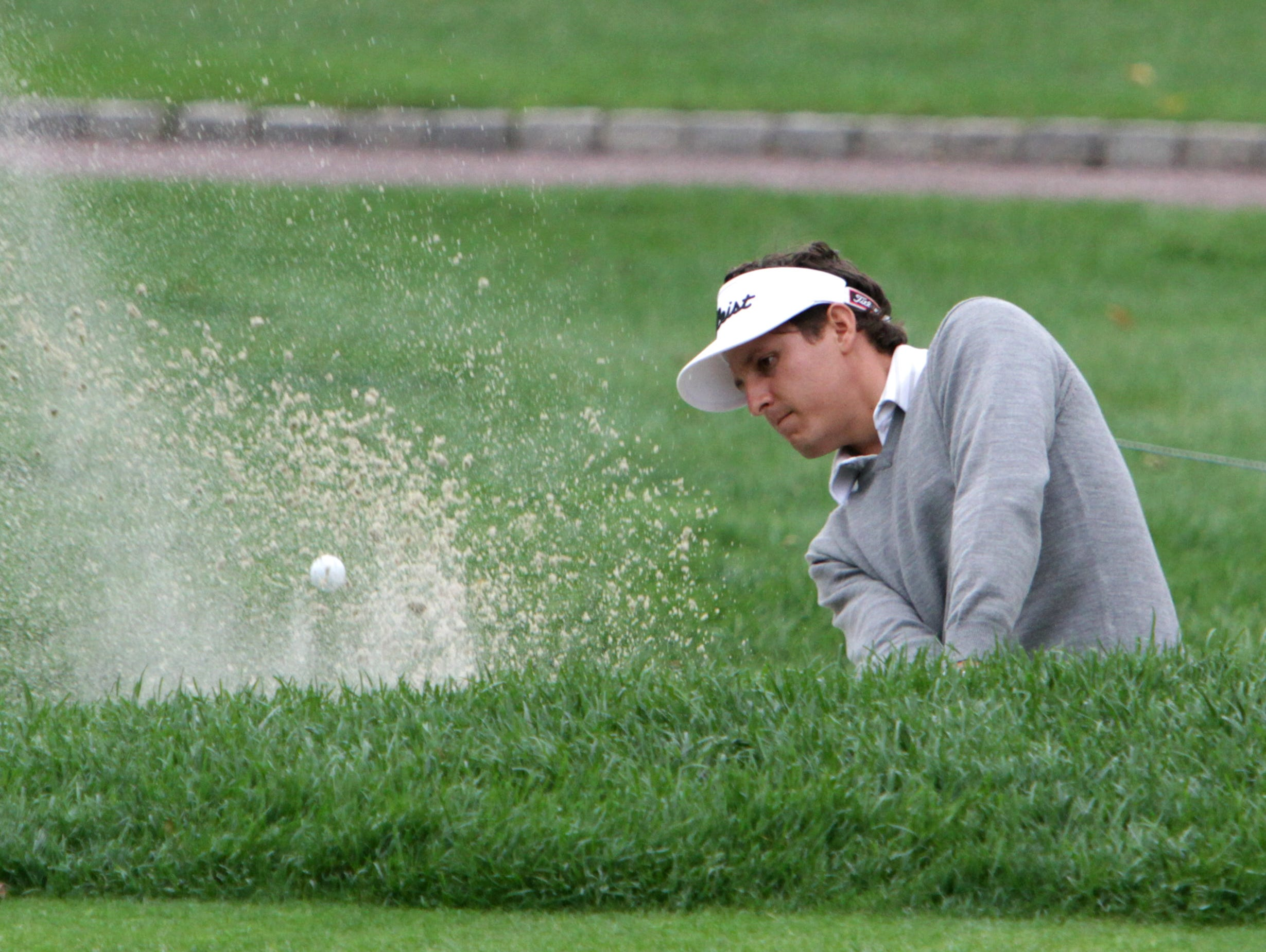 Tyler Jaramillo pumps shoots out of a bunker on the 18th in a play-off against Matt Dobyns in the final round of the Met PGA Championship at Fenway Golf Club Oct. 1, 2015. Dobyns won.