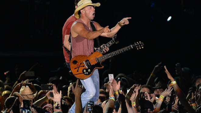 Kenny Chesney performs 50,000 fans at Lambeau Field on Saturday.