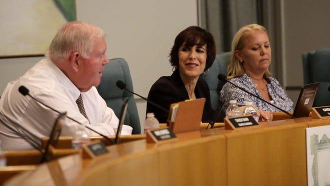 Palm Beach County School Board member Karen Brill, center, at a school board meeting in 2014.