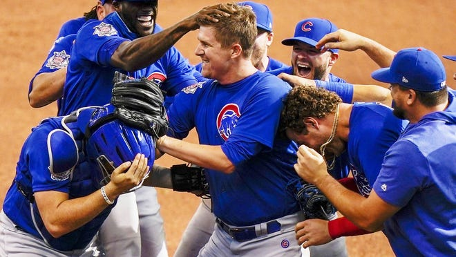 Chicago Cubs starting pitcher Alec Mills is swarmed by teammates after throwing a no hitter at a baseball game against the Milwaukee Brewers Sunday, Sept. 13, 2020, in Milwaukee. The Cubs won 12-0.