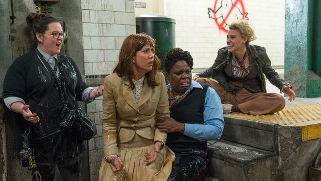The new 'Ghostbusters' (from left, Melissa McCarthy, Kristen Wiig, Leslie Jones and Kate McKinnon) deal with slime at work.