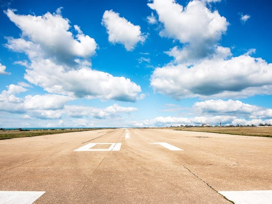 Runway, airstrip in the airport terminal with marking on blue sky with clouds background. Travel aviation concept...