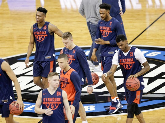 Syracuse players including Oshae Brissett (11), Tyus Battle (25) and Frank Howard (23) warm up during practice at the NCAA men's college basketball tournament, in Omaha, Neb., Thursday, March 22, 2018. Syracuse faces Duke in a regional semifinal on Friday. (AP Photo/Nati Harnik)