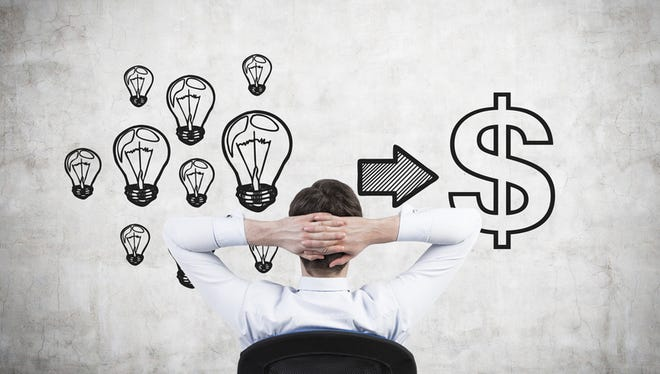 businessman drawing turning ideas into money on poster