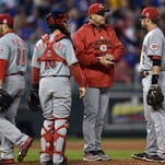 Reds manager Bryan Price (center) takes pitcher Jason Marquis (left) out of Wednesday's game against the Royals.