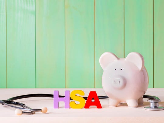 Piggy bank with HSA block letters next to it