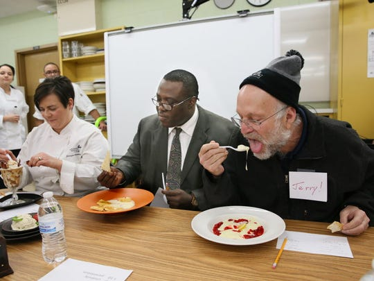 Jerry Greenfield (right), co-founder of the premium ice-cream brand Ben & Jerry's, tastes one of the ice cream contest entries. The other judges were Jennifer Bartolotta (left) of the Bartolotta Restaurant Group and James Madison Academic Campus Principal Greg Ogunbowale.