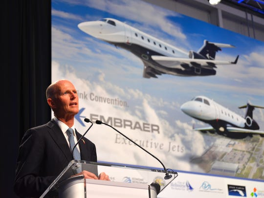 Gov. Rick Scott speaks at Orlando Melbourne International Airport morning for a ribbon-cutting at Embraer's Legacy jet assembly operation in 2016.