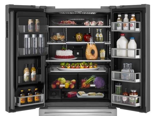 This Jenn-Air refrigerator has a charcoal-colored interior called Obsidian, with LED lighting.