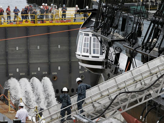 Water from the Boston Harbor is pumped into a dry dock