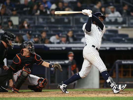 Apr 6, 2018; Bronx, NY, USA; New York Yankees shortstop Didi Gregorius (18) hits a solo home run against the Baltimore Orioles during the eighth inning at Yankee Stadium.