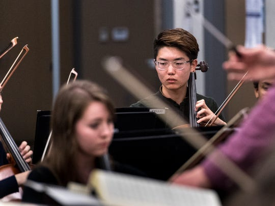 Joseph Kim rehearses with the Sequoia Symphony at Ridgeview Middle School on Monday, April 16, 2018.