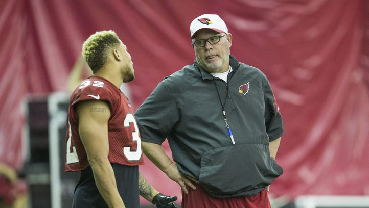 Arizona Cardinals safety Tyrann Mathieu (32) talks with head coach Bruce Arians during practice inside the practice bubble at their training facility in Tempe August 31, 2015.