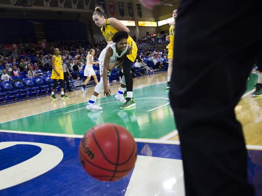 Florida Gulf Coast University junior, Rosemarie Julien, falls as she tries to save the ball from going out of bounds during the game against Siena College on Friday, December 9, 2016 at Alico Arena in Estero, Fla.