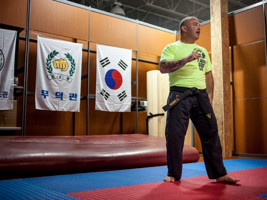 Fort Gratiot Tang Soo Do instructor Chris Garcia leads a training session Wednesday, June 28, 2016 at Kaleidoscope Gym in Kimball Township.