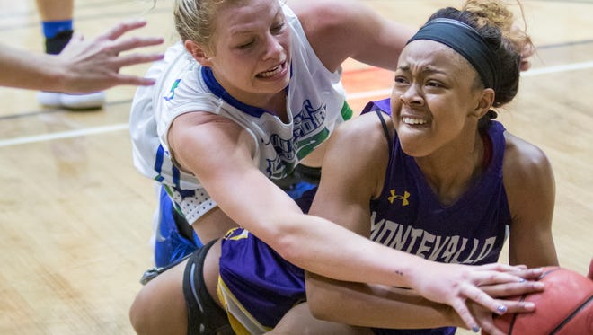 Halee Nieman (32) and Kiya Sain (11) fight for the ball during the Montevallo vs UWF women's basketball game at the University of West Florida in Pensacola on Monday, December 18, 2017.