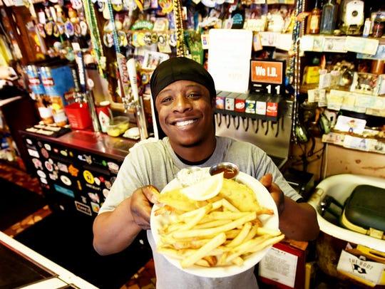 Herbi K's manager Charlie Lee holding the Shrimp Buster.
