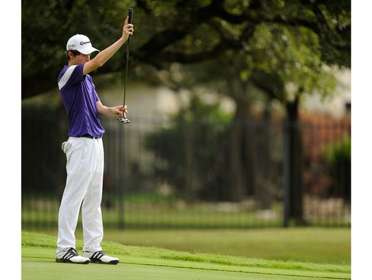 Merkel's Colton Hilburn lines up his putt on the fourth