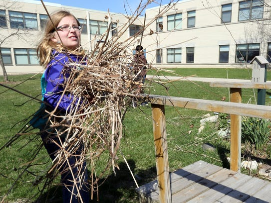 Swanson School fifth-grader Maddie Foley carries brush