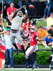 Vanderbilt safety Oren Burks (20) nearly intercepts
