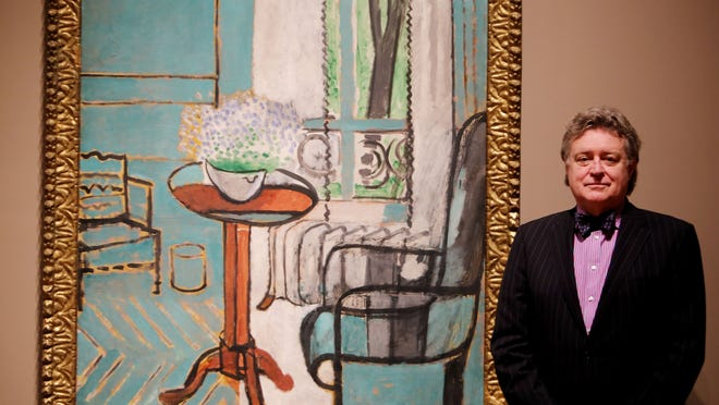 """Graham Beal, director of the Detroit Institute of Arts, is retiring at the end of June. He is photographed by one of his favorite pieces, """"The Window,"""" by Henri Matisse, on Wednesday. Beal's tenure has been highlighted by a $158-million renovation and reinstallation of the museum's collection."""