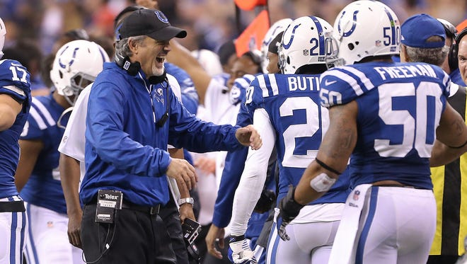 """""""It doesn't matter if you're a practice squad player or whatever.  ... He's going to treat you the same way,"""" Jerrell  Freeman says of coach Chuck Pagano. """"He loves us all equally."""" Here, Pagano congratulated Freeman and others on the defense in a game against the Chiefs  in 2013."""