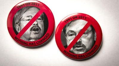 A ban on pins worn by state prison employees that reflect unfavorably on Iowa Gov. Terry Branstad has been upheld by a Polk County District Court judge.