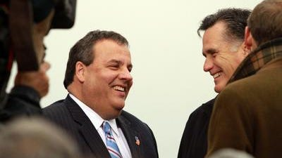 Republican presidential candidate Mitt Romney, right, with New Jersey Gov. Chris Christie, left, during a Romney campaign appearance at a Hy-Vee grocery store in West Des Moines area on, Friday, Dec. 30, 2011.