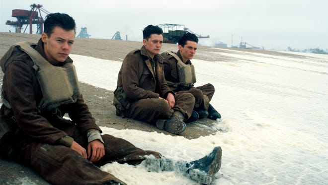 """Harry Styles, from left, Aneurin Barnard and Fionn Whitehead appear in a scene from """"Dunkirk."""""""