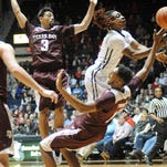Mississippi guard Stefan Moody (42) is fouled by Texas A&M center Tonny Trocha-Morelos (10) while driving past guards Alex Robinson (3) and Peyton Allen (22) during an NCAA college basketball game Wednesday, Feb. 4, 2015, in Oxford, Miss. (AP Photo/Oxford Eagle, Bruce Newman)