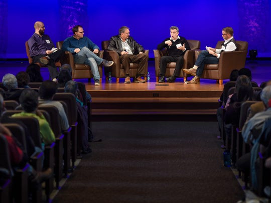 Panelists take questions from the audience during an