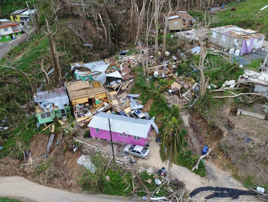 Several homes, seen from above from a drone, that has