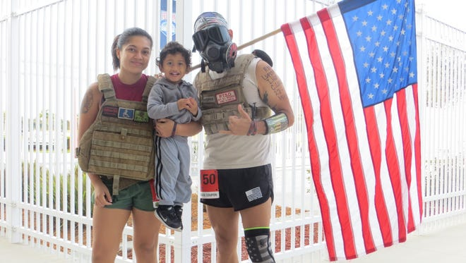 Will Ortiz and his family showed up for Saturday's Run to Home Base Florida. Ortiz says he often wears this outfit to races to draw attention to PTSD and other hardships that veterans endure. His wife, retired soldier Ily Lopez, also ran the race with a weighted vest.  Pictured are Lopez, Ortiz and their 2-year-old son, Donnie Ortiz.